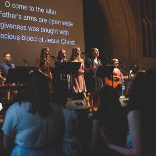 Students leading worship