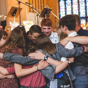 A group of students in prayer