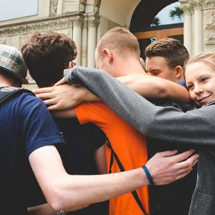 A group of Awakening students hugging each other