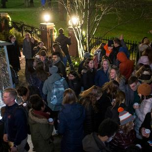 College students enjoy hot chocolate on the patio of the president's home prior to the annual Christmas Tree Lighting.