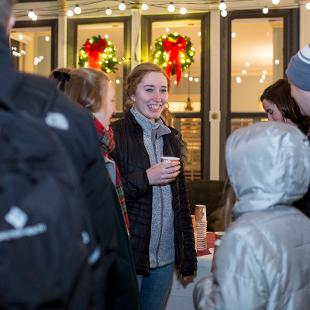 President Scogin mingles with college students on the patio of the president's home prior to the annual Christmas Tree Lighting.