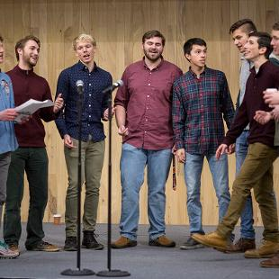 College students sing Christmas Carols.