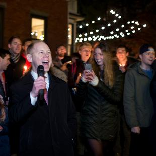 President Scogin celebrates the lighting of the tree.