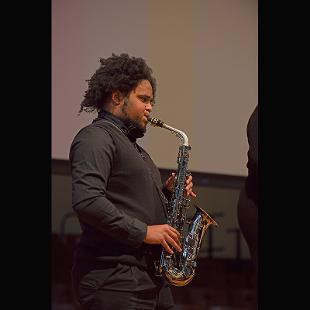 Houston Patton performs on saxophone with the Gospel Choir