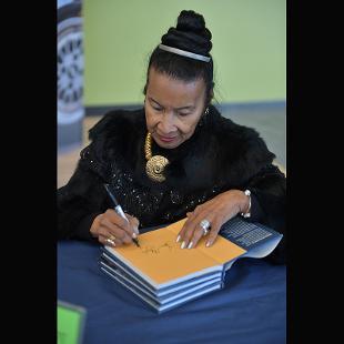 Keynote Speaker Xernona Clayton autographs her autobiography