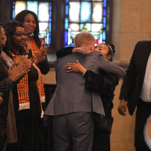 President Matthew Scogin hugs Xernona Clayton after she speaks