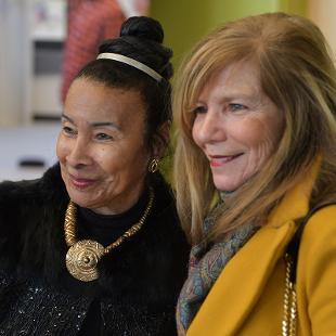 A woman has her photo taken with  Xernona Clayton