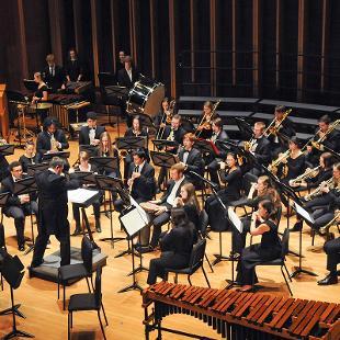 "Members of the Wind Ensemble perform ""Strange Humors"" by John Mackey."
