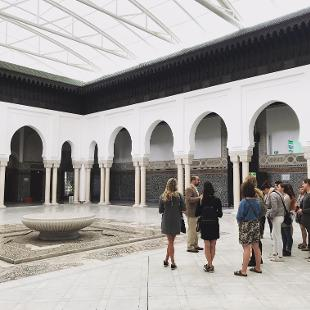 A group of people standing inside a mosque