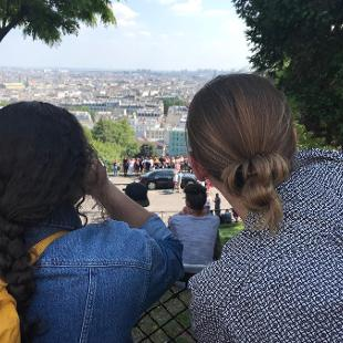 Two people looking out over a cityscape