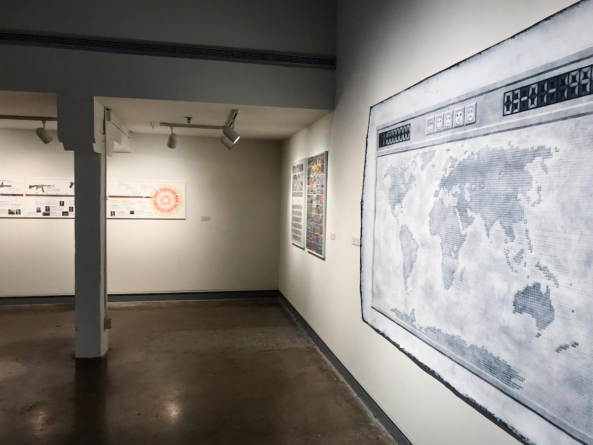 """View of art from """"Middle Grounds"""" on the De Pree Gallery walls."""