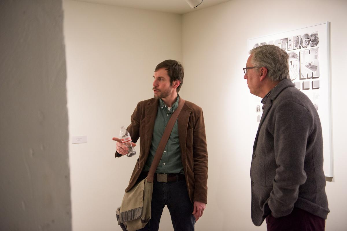 Two people in conversation in the De Pree Gallery.