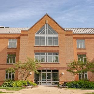 The exterior and front entrance of  Cook Residence Hall.