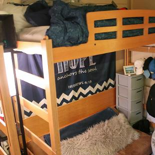 Beds lofted in a student room