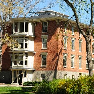 Exterior of Van Vleck Residence Hall from the Pine Grove