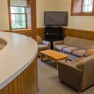 Van Vleck Residence Hall lounge with seating area.