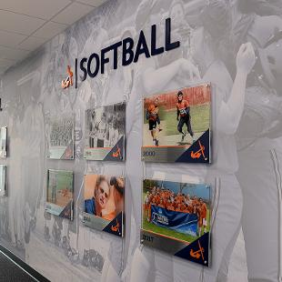 One the hallway walls is a timeline display with captions and photos of the history of football, baseball and softball at Hope College.