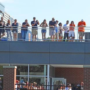 Visitors enjoy the sky deck on the Jim Heeringa Athletic Center following the dedication.