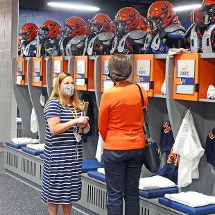 Guests visit the lockerroom ollowing the dedication.