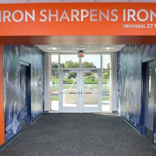 """The entry to the football field has the phrase """"Iron Sharpens Iron"""" from Proverbs 27:17"""