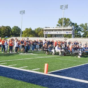 A view of the people attending the dedication event from the visitor sidelines.
