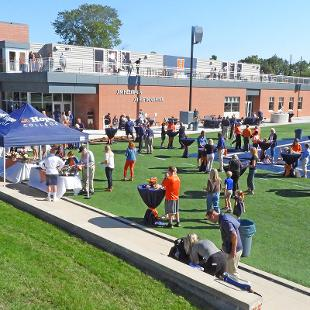 Guests mingle outside the Jim Heeringa Athletic Center following the dedication.