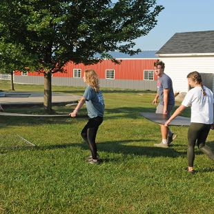 Four students move stuff at the new Critter Barn location.