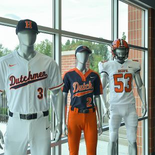 mannequins display the currnt baseball, softball and football uniforms.