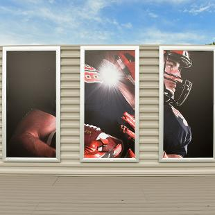 The open sky deck features A three-panel photo display showcasing a a student in his football gear.