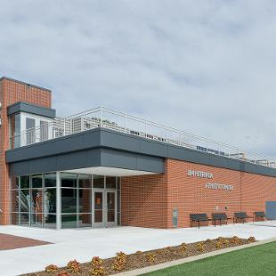 Full view of the Jim Herringa Athletic Center taken from west sideshowcasing the front and the entry way.