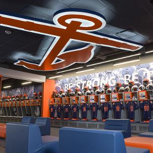 The locker room has 125 lockers and has dividers so it can be used for football in the fall and for the baseball and softball teams in the spring. There is a huge anchor mounted to the ceiling.