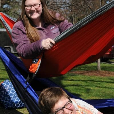 Students in hammocks in the Pine Grove.