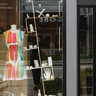 Student sculptures and a dress in the front window of Frances Jaye