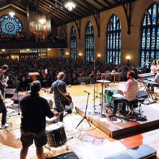 A worship band plays in front of a crowd at Dimnent Memorial Chapel.