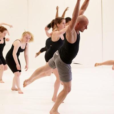 Dance students follow the instruction of their professor
