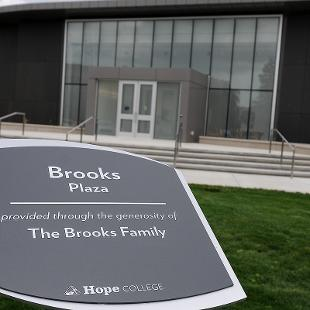 Outside plaque recognizing Brooks Park with the Kruizenga Art Museum behind.