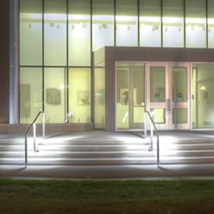 The finished Kruizenga Art Museum is shown lit up at night.