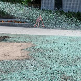 Liquid grass being sprayed in the area between the Kruizenga Art Museum and Campus Safety.