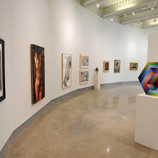 The first exhibit of paintings have been hung on the walls.