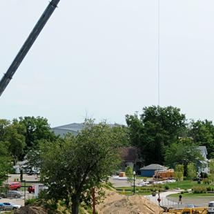 A wide-shot of a crane above the construction site.