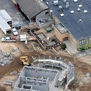 An aerial view of the site midway through construction.