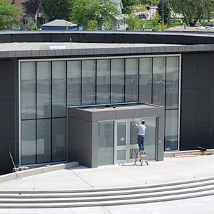 The nearly completed Kruizenga Art Museum with dirt around it.