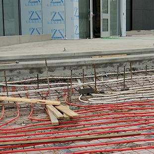 Setting the tubing for the heated sidewalks and entryway into the building.