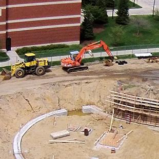 Aerial view of construction as concrete panels are placed.
