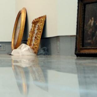 Artwork on the floor of the Kruizenga Art Museum as they prepare to layout their permanent collection.