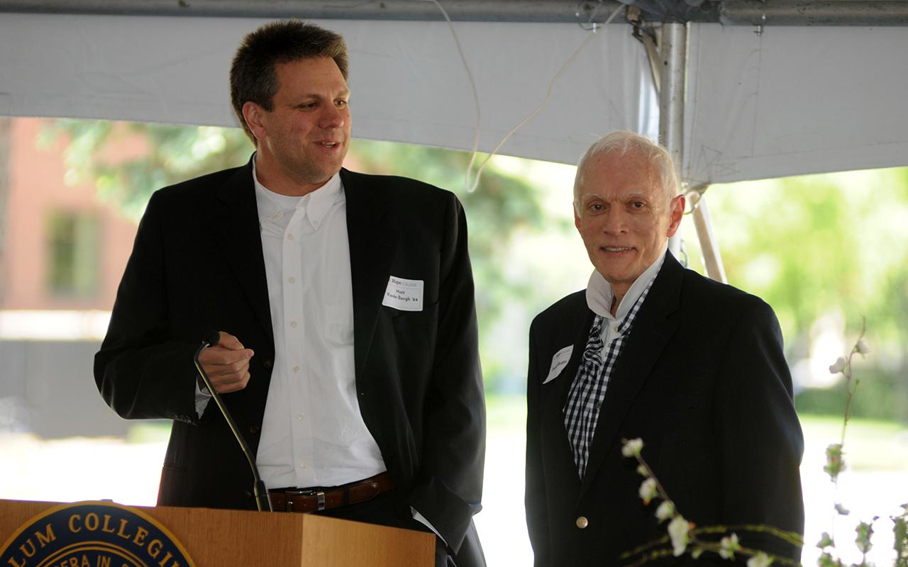 Architect Matt VanderBorgh speaking at a podium at the groundbreaking.