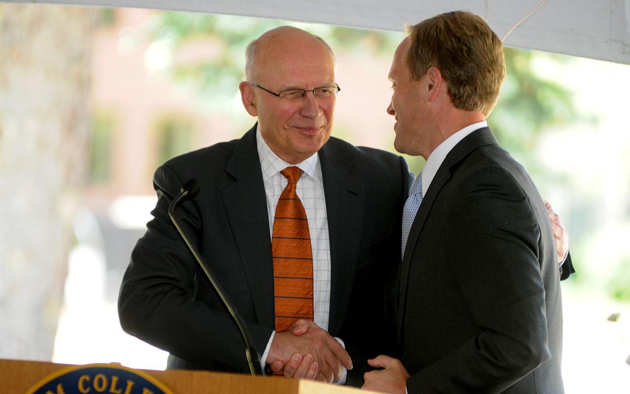 President Emeritus James Bultman shaking hands with Former Holland mayor Kurt Dykstra.
