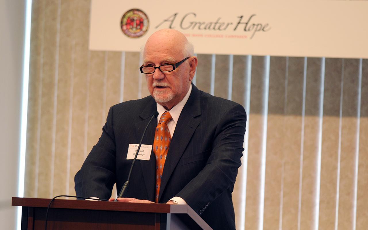 Dr. Richard Kruizenga speaking at a podium.