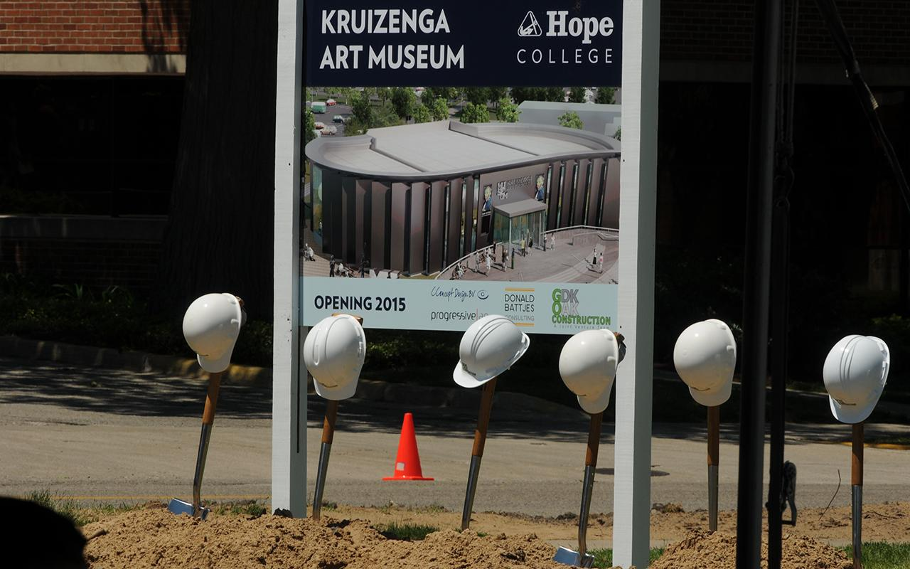 Construction hats on shovels in front of the Kruizenga Art Museum sign.