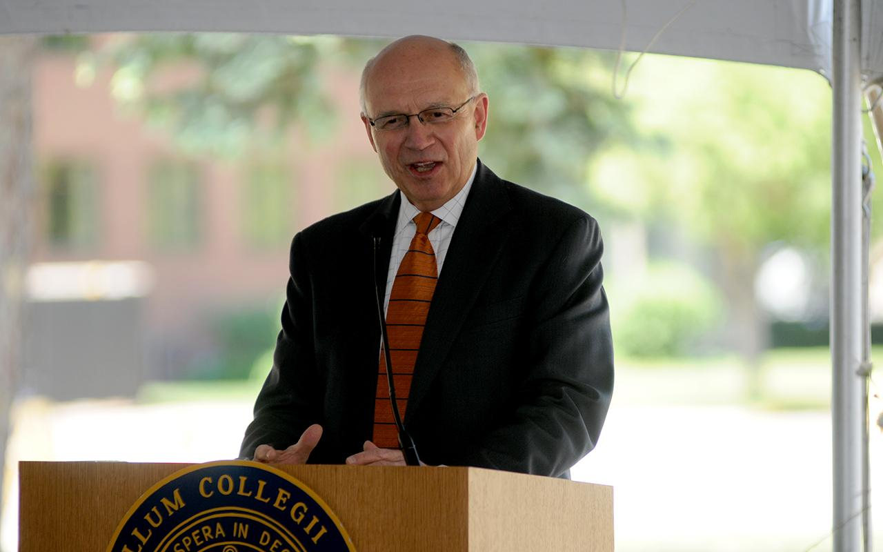 President Emeritus James Bultman speaking at a podium at the groundbreaking.